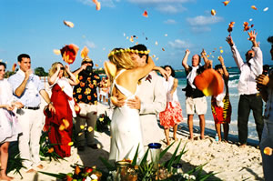 """At the end of the ceremony, all the guest throw flower petals to the bride and groom"